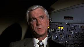 Leslie Nielsen as Dr. Rumack in the movie Airplane! And don't call me Shirley.