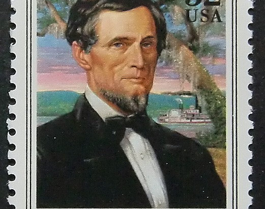 Jefferson Davis United States 32 cent postage stamp 1995 with Mississippi River steamboat and magnolia tree behind him
